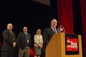 Chuck Taylor accepting the award for 100 Best Companies to work for in Oregon.